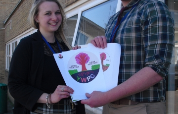 Westfield academy art staff holding YWPC logo
